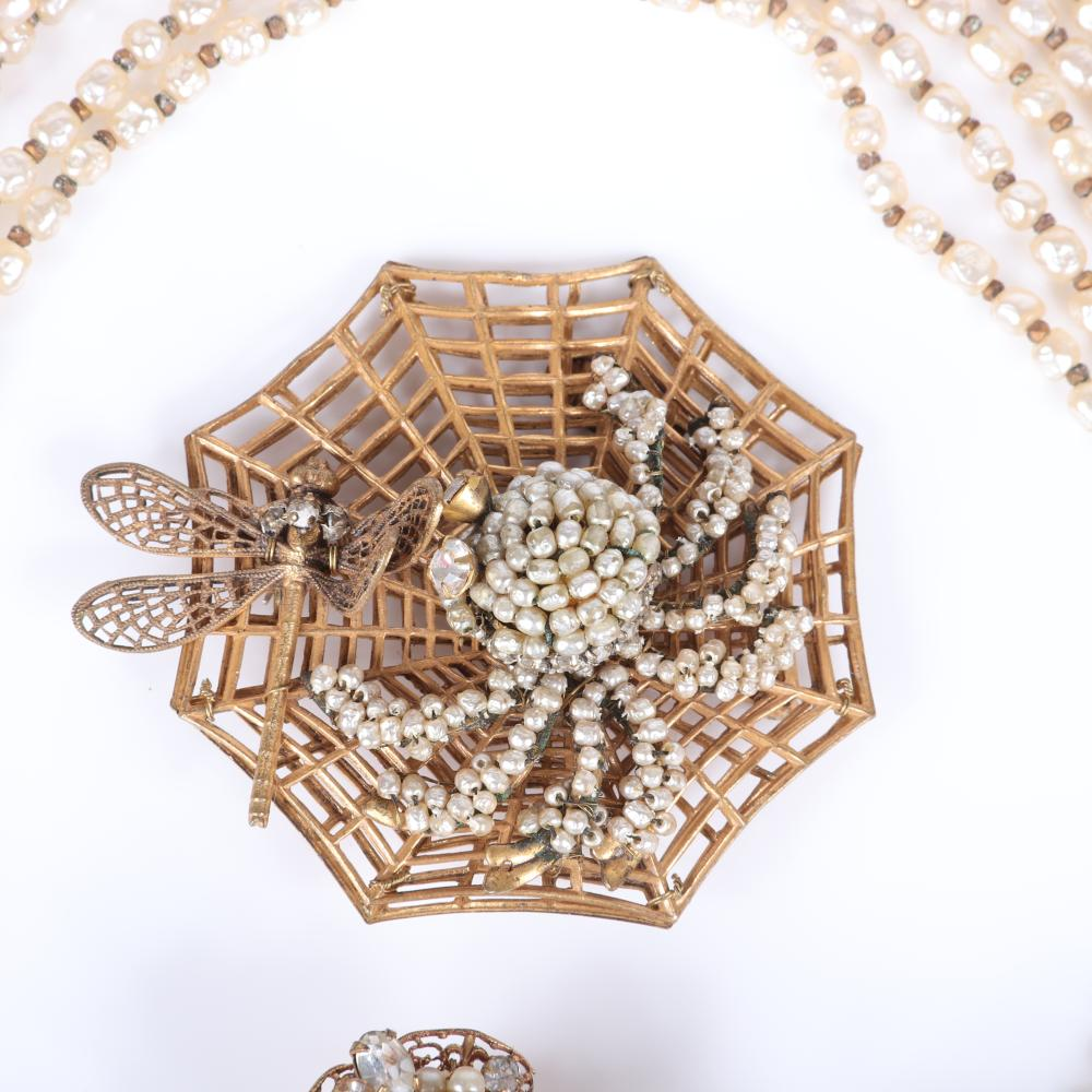 """Miriam Haskell seven graduated strand faux pearl necklace, large figural openwork spider web and dragonfly brooch, Robert faux pearl and rhinestone earrings. 15""""L (necklace)"""