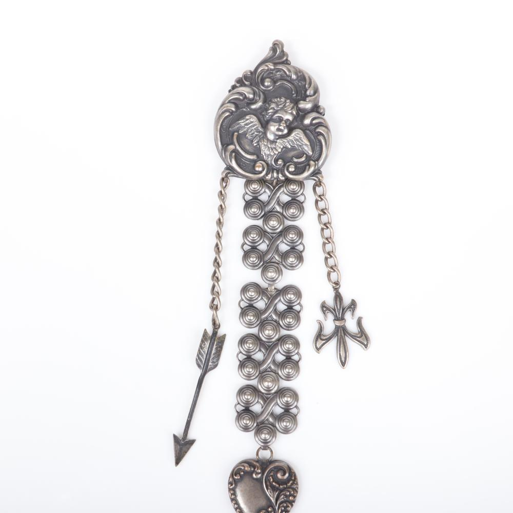 """Joseff of Hollywood silver tone group repousse brooch with cherub and dangling heart, fleur de lis and arrow charms with earrings with three heart shaped leaves. 7""""H x 2 1/3""""W (brooch)"""
