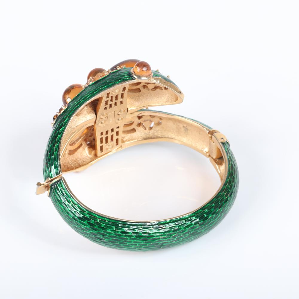 """Trifari L'Orient double snake head bypass bracelet with matching button earrings with textured green enamel snakeskin and citrine cabochons and rhinestones, 1960s. 2 1/4"""" inner width, 1""""H (earrings)"""