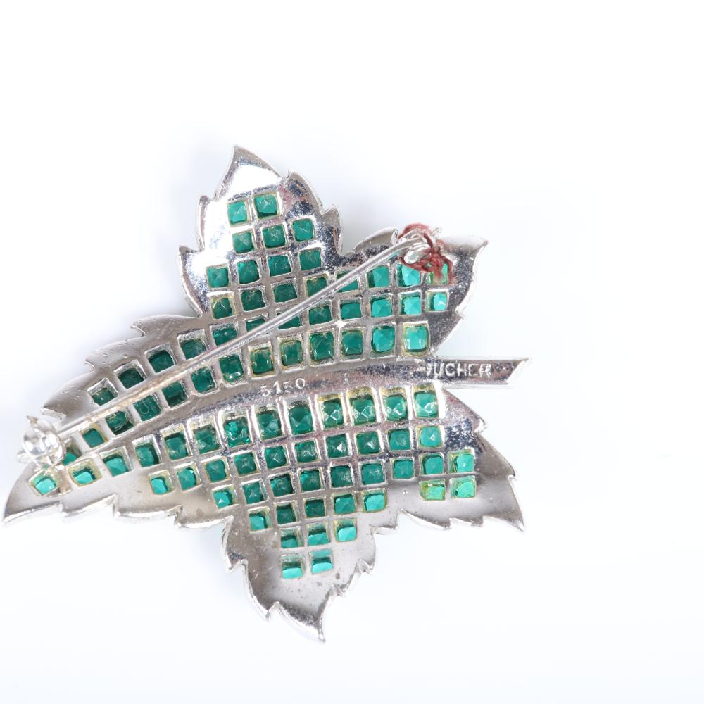 """MB Boucher and Trifari pave and emerald crystal 3pc group: Boucher large brooch and sterling clip, paired with Trifari earrings with green crystal baguette details. 2""""H (pin), 1 1/8""""H (earrings)"""