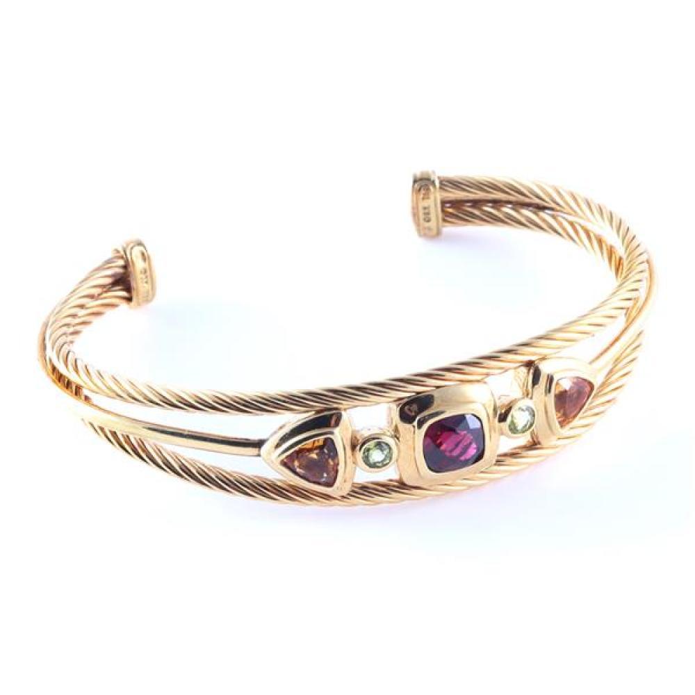 "David Yurman 18K gold twisted cable cuff bracelet with bezel set semi precious gem stones - citrine, garnet, and peridot. 2 1/2""inner width, 1 1/4""opening, 18.3dwt"