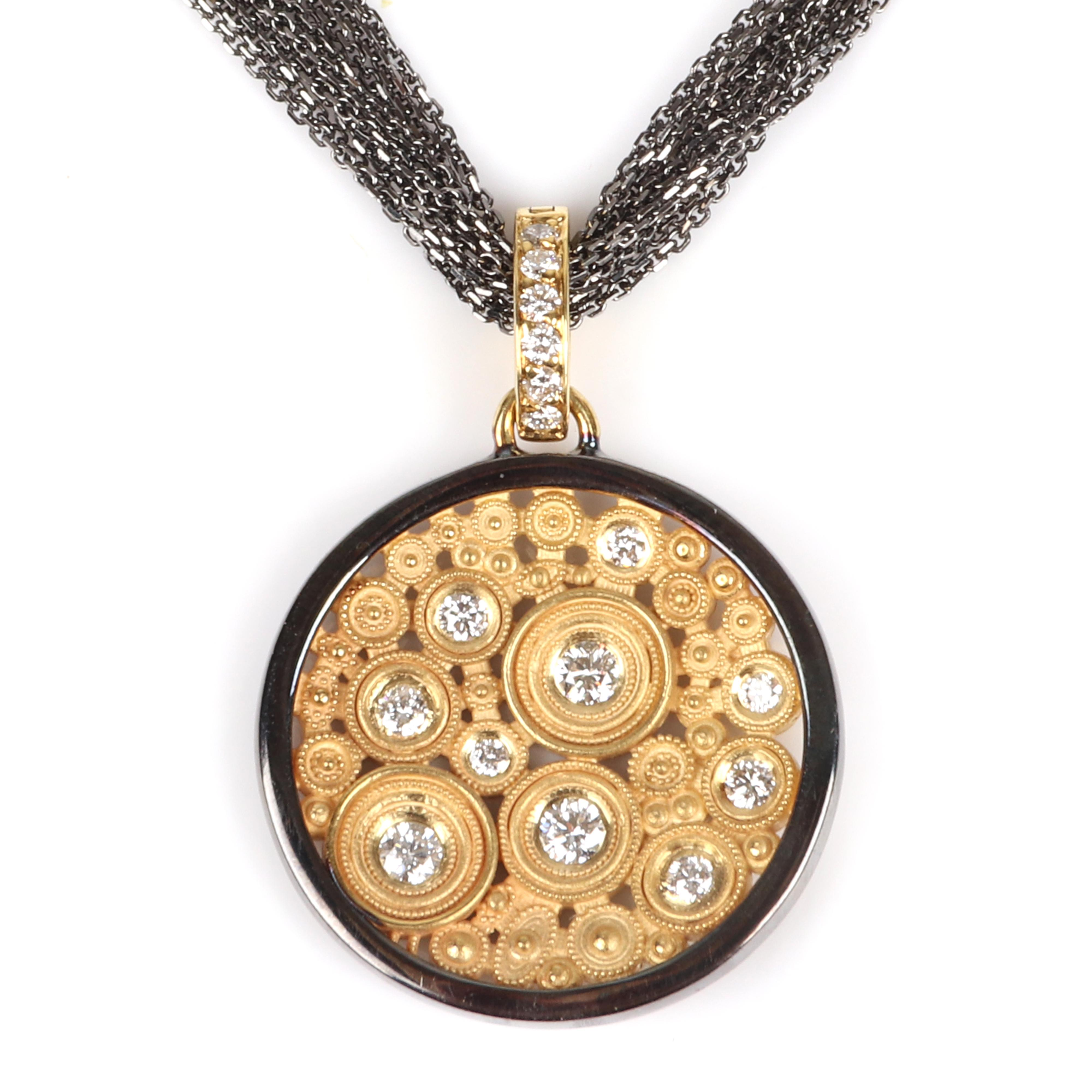 "18K yellow and black gold and diamond circle pendant on multi 10 strand stamped 18K black gold chain. 21"" longest length, 7/8"" diam. (pendant) 14.15 dwt."