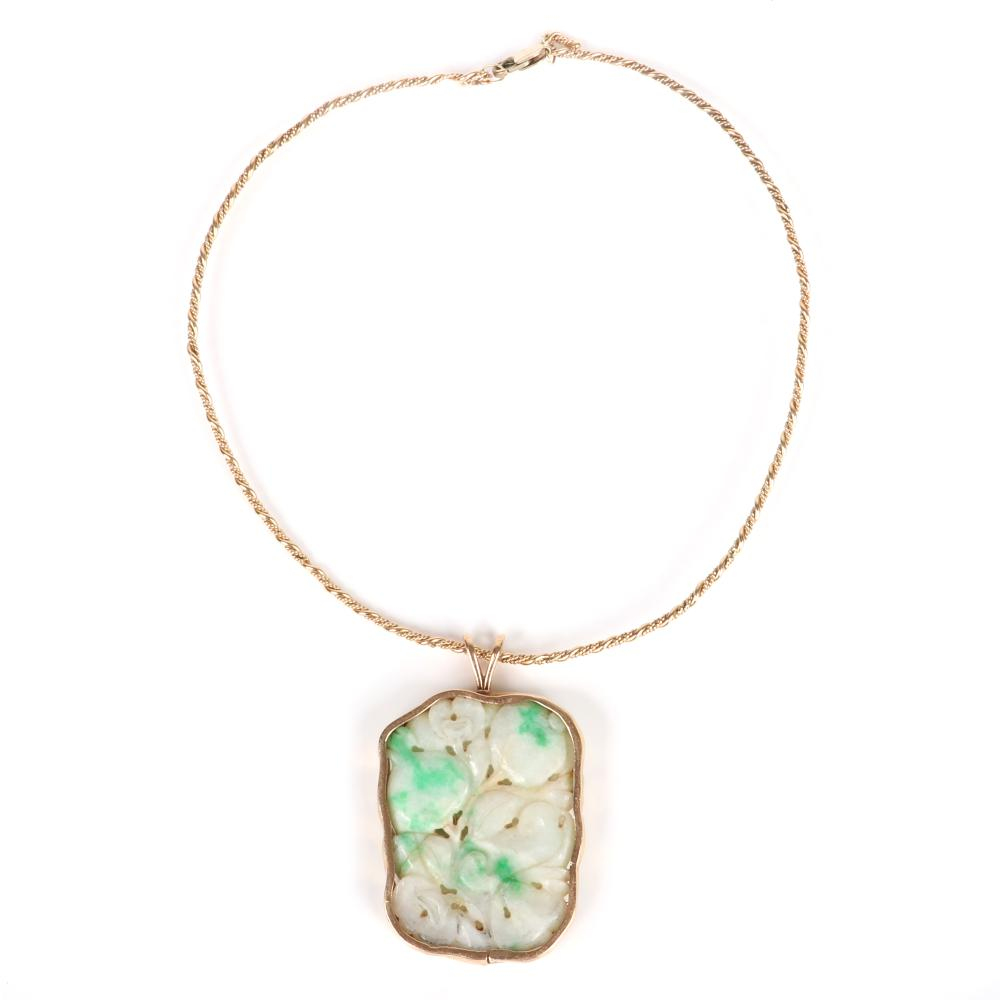 """Chinese carved jade fruit and flowers antique ornament mounted in 18K yellow gold bezel with 18K wire choker necklace. 16""""L, 2 1/2""""H x 1 1/2""""W (pendant). Pendant, 24.25dwt. Wire, 9.00dwt."""