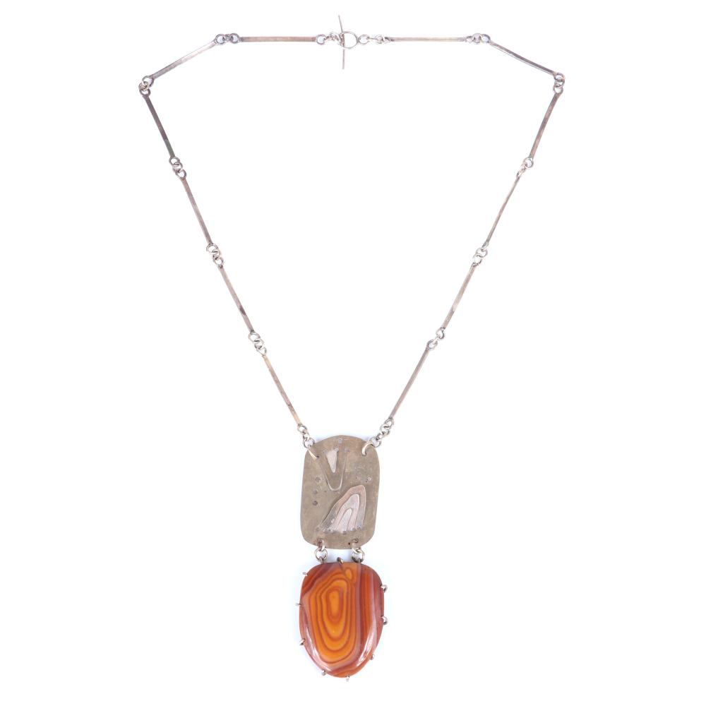 """Mildred Ball American Modernist sterling silver necklace and pendant with metal-worked disk and brown stone drop, with handmade bar and link chain and toggle clasp. 18""""L, 3 1/2""""H x 1 1/4""""W (pendant)"""