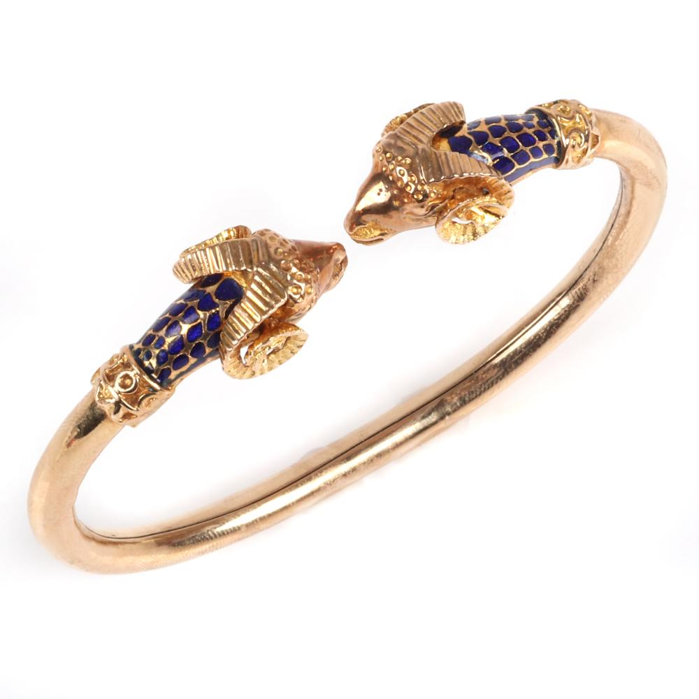 "Stamped 585 14K yellow gold and enamel designer ram head / Aries figural cuff bracelet. 2 1/2"" inner width 13mm widest. 12.55 dwt"