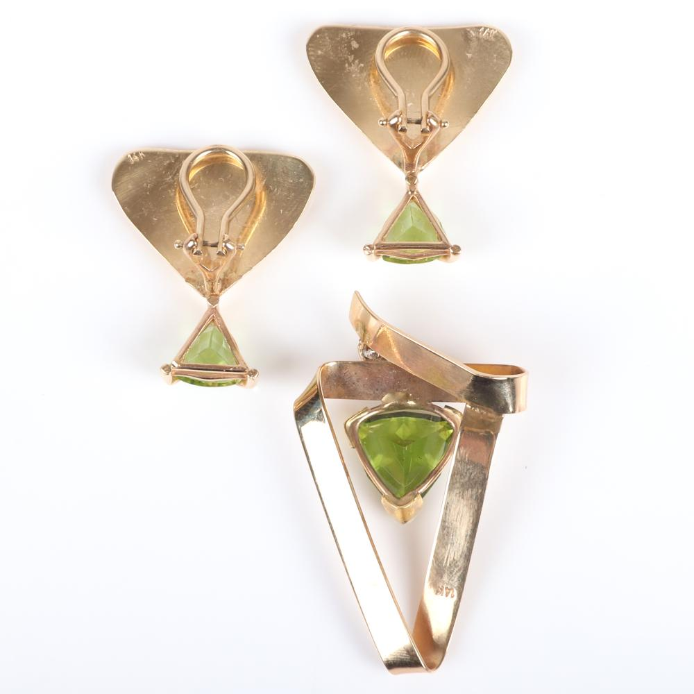 """Stamped 14K yellow gold modernist pendant and clip earring set with trillion cut peridot and small diamond accent. 1 1/2"""" H x 1""""W (pendant) 1""""H (earrings) 6.30 dwt."""