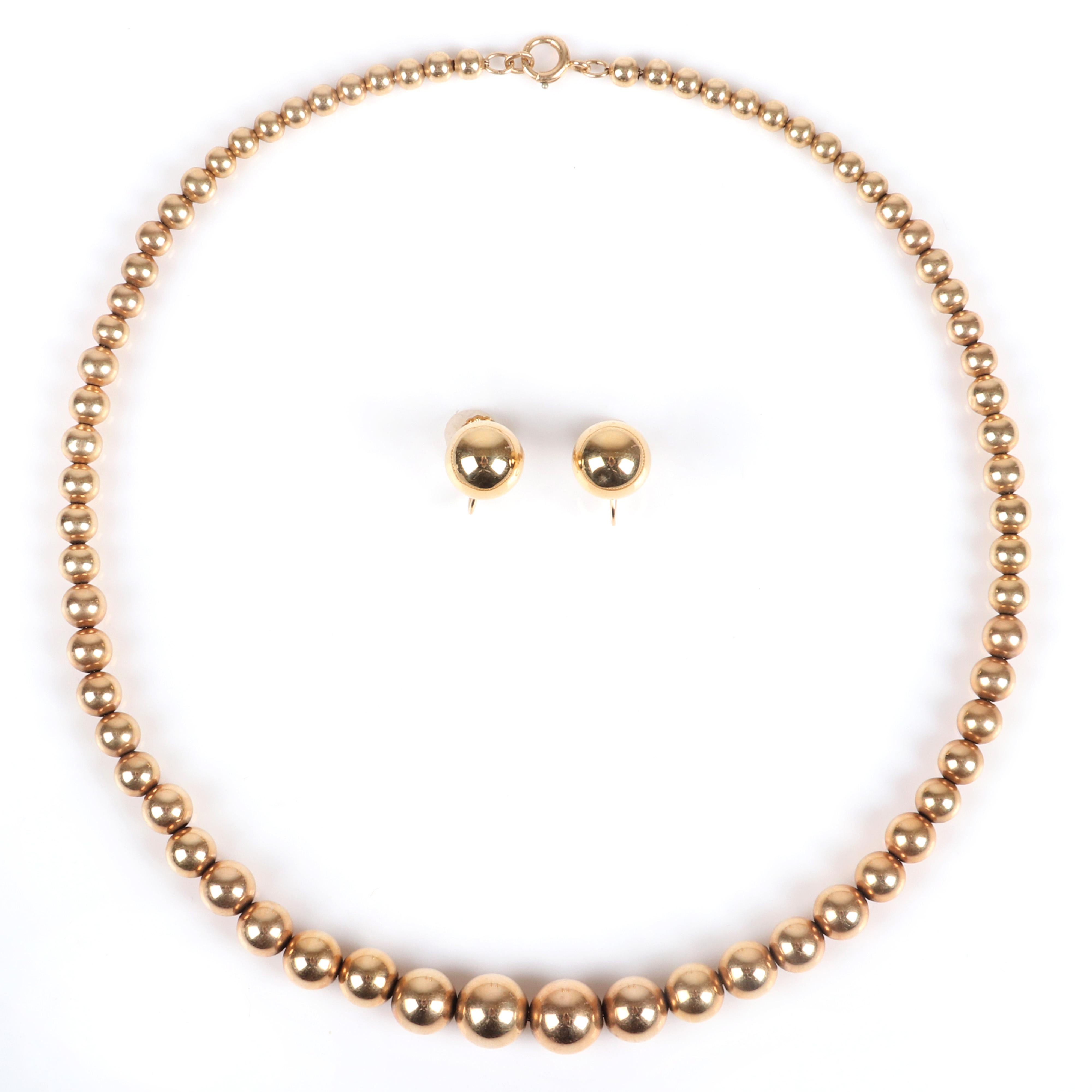 """Stamped 14K yellow gold 13.05dwt graduated bead necklace and earring set. 16""""L, (necklace), 1/2"""" diam, (earrings) 13.05 dwt"""