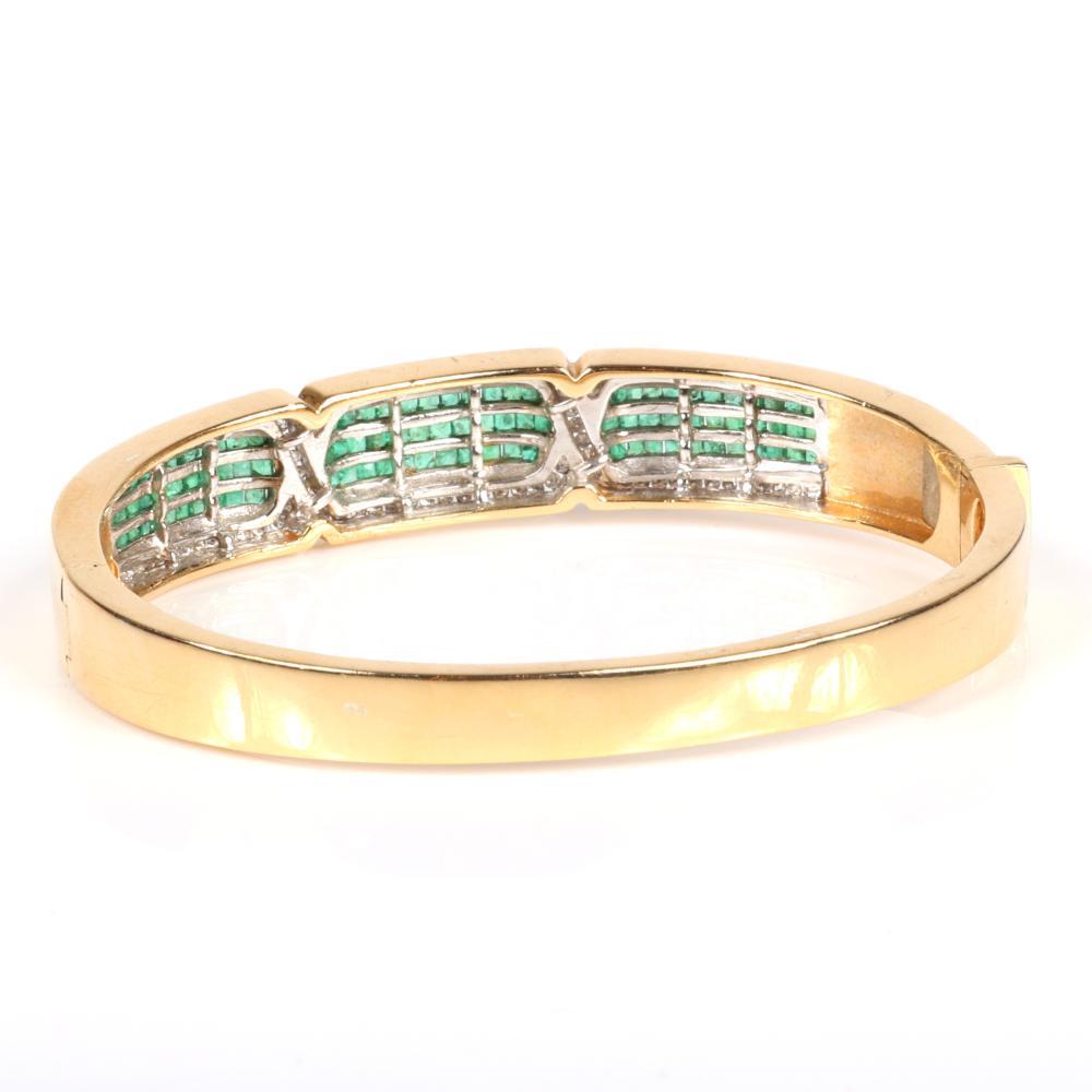"Emerald and diamond 14K yellow gold hinged cuff bangle bracelet. 2 1/4"" inner diam. 1/2""W"