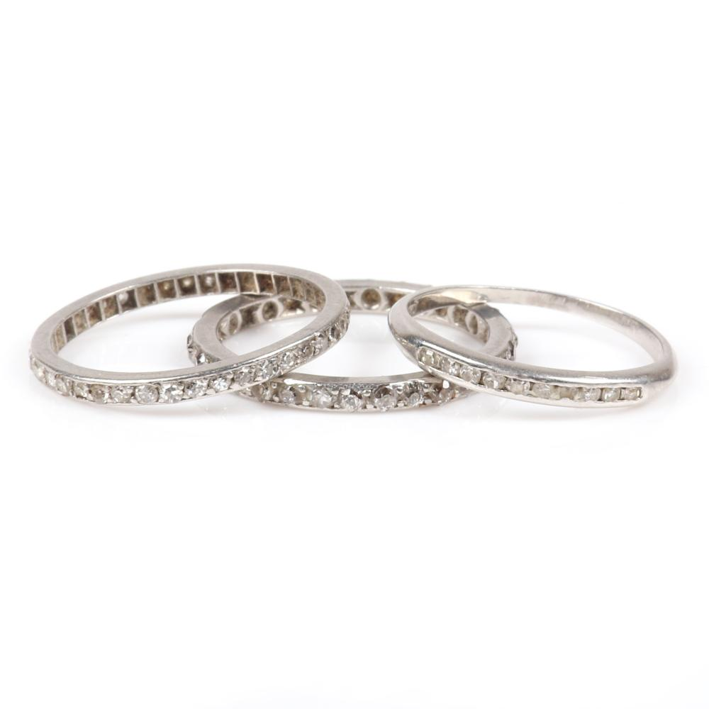 Three Art Deco platinum & diamond rings: two stacking eternity bands encircled with diamonds and one with channel set diamonds along the top. Size 6 (two rings encircled with diamonds, Size 5 (diamonds on top)