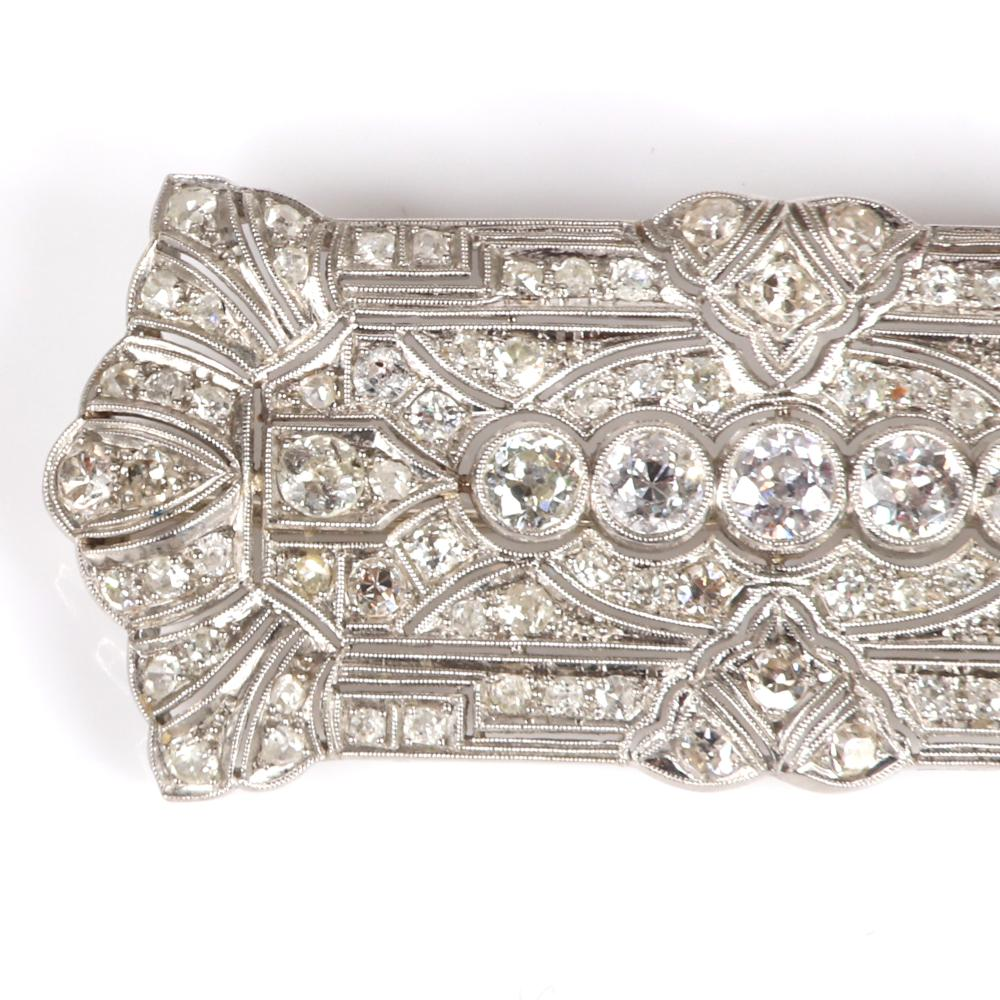 "Antique Art Deco estate platinum and diamond brooch 1""H x 2 1/4""W"