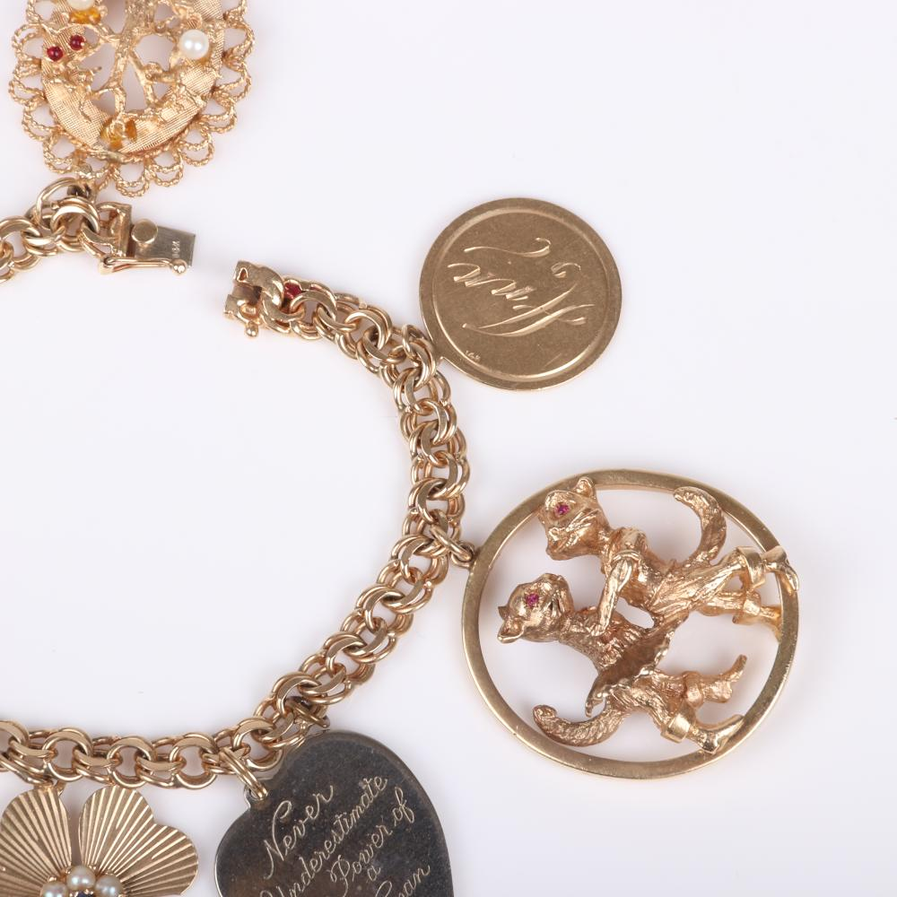 """Vintage 14K yellow gold charm bracelet with large jeweled and figural pendant charms, 60.65 dwt. 7"""" L"""