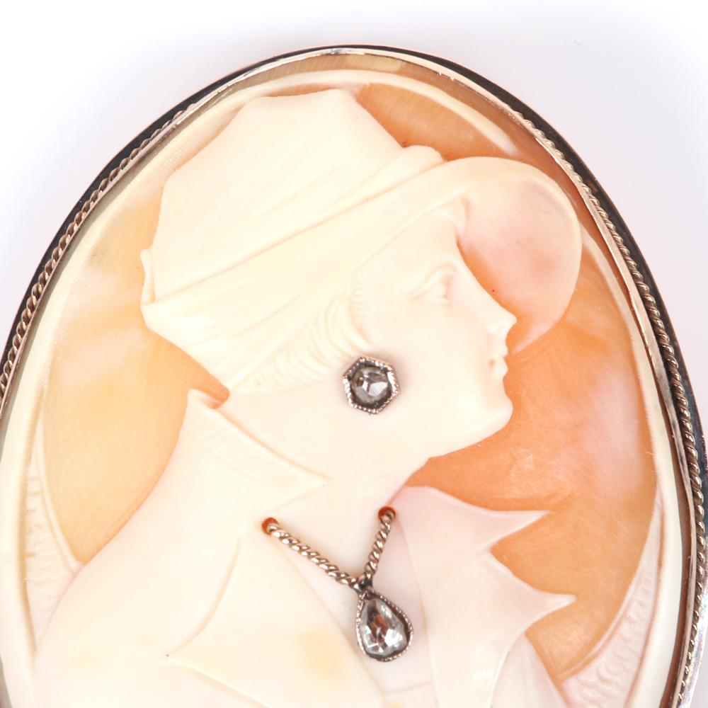 """Art Deco shell Cameo pin / pendant ca.1920 female bust in fashionable hat with mine cut teardrop and round diamonds in earring and necklace in low carat gold mount. 2 1/4""""H x 1 3/4""""W"""