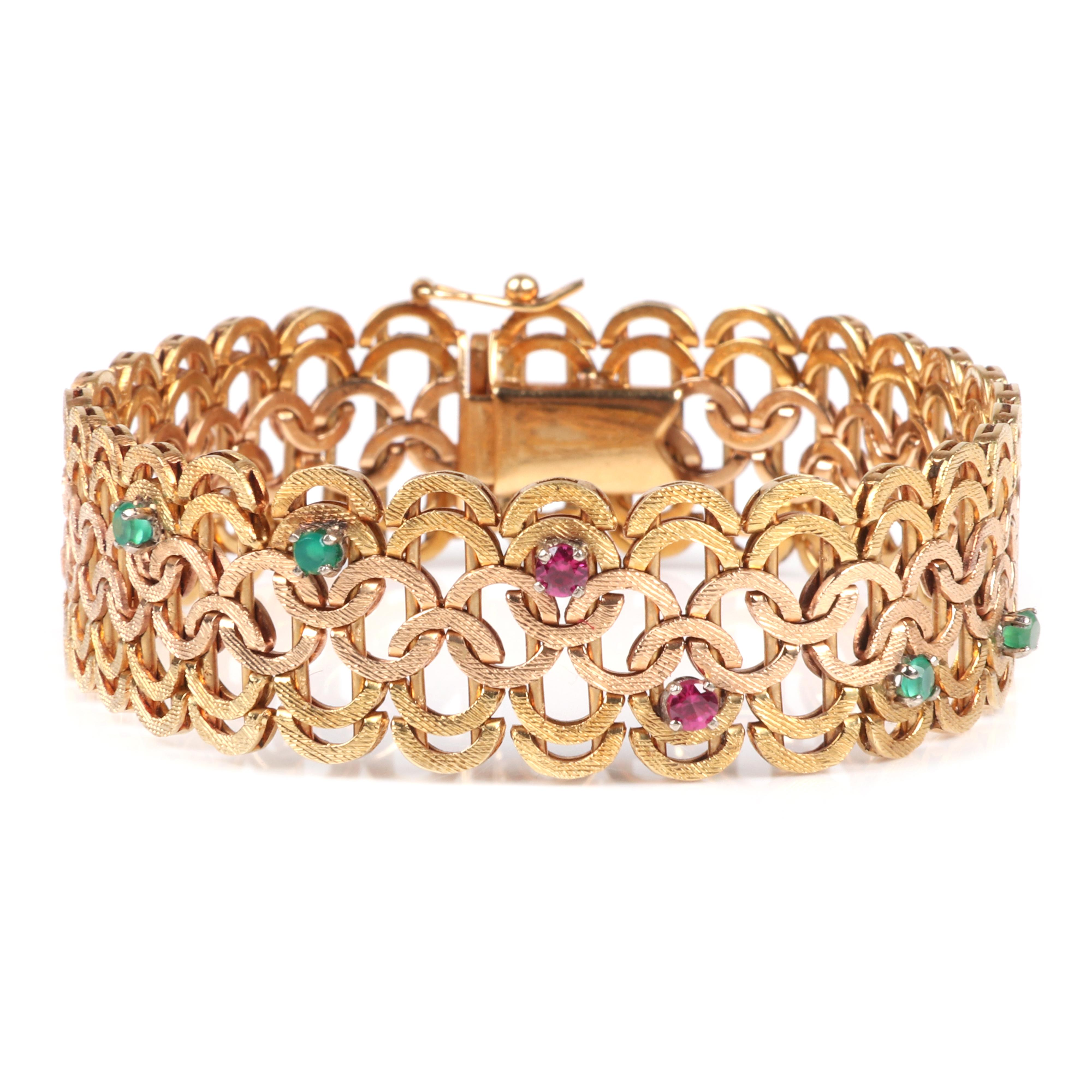 """Stamped 18K yellow antique gold 21.15dwt vintage retro estate bracelet with ruby and emerald gem accents in an interwoven open circle motif. 7 1/2""""L, 21.15 dwt"""