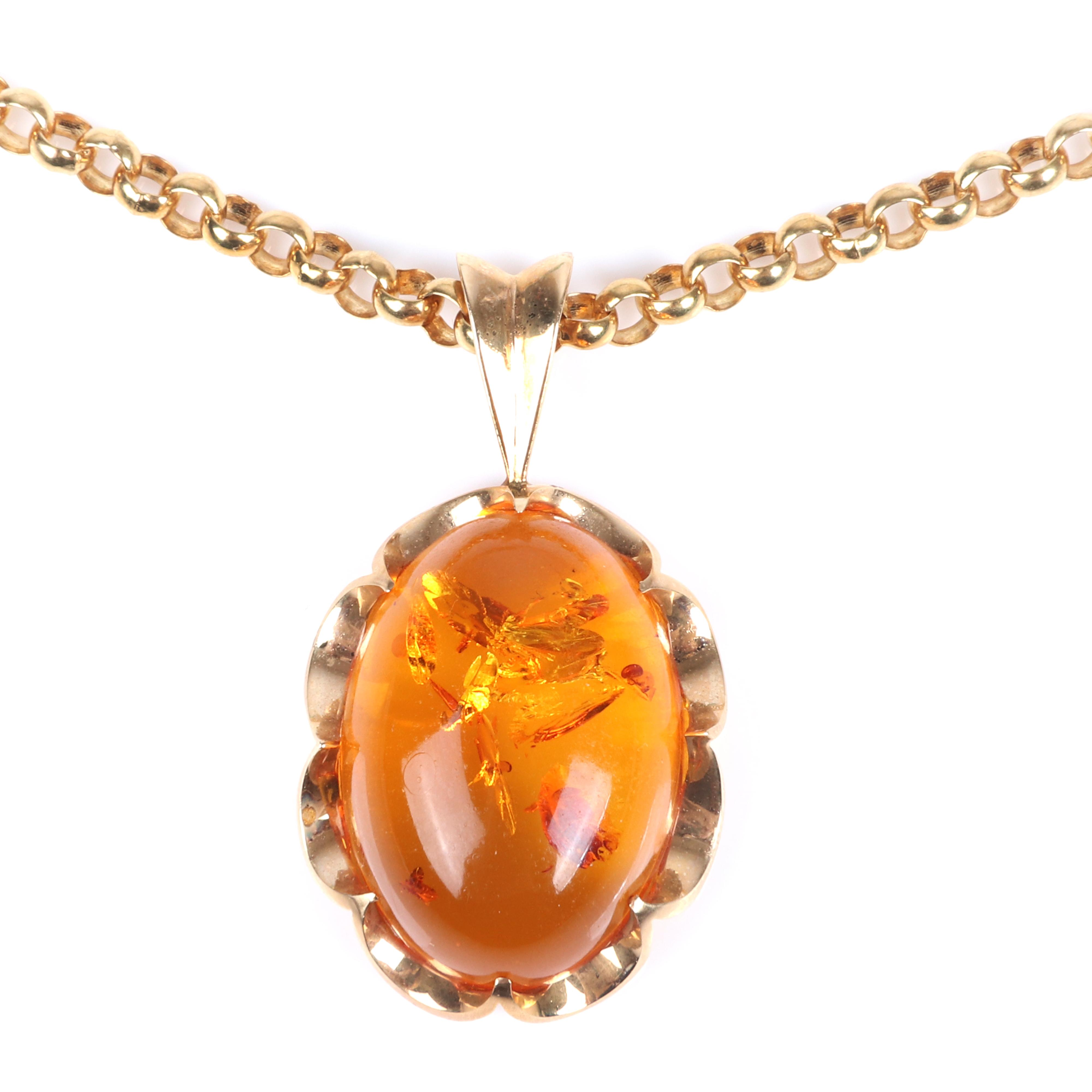 """Stamped 14K yellow gold mounted amber cabochon pendant on stamped 585 3.5mm circle link chain. 20""""L, 1 1/2"""" x 1"""" (pendant) 16.35 dwt"""