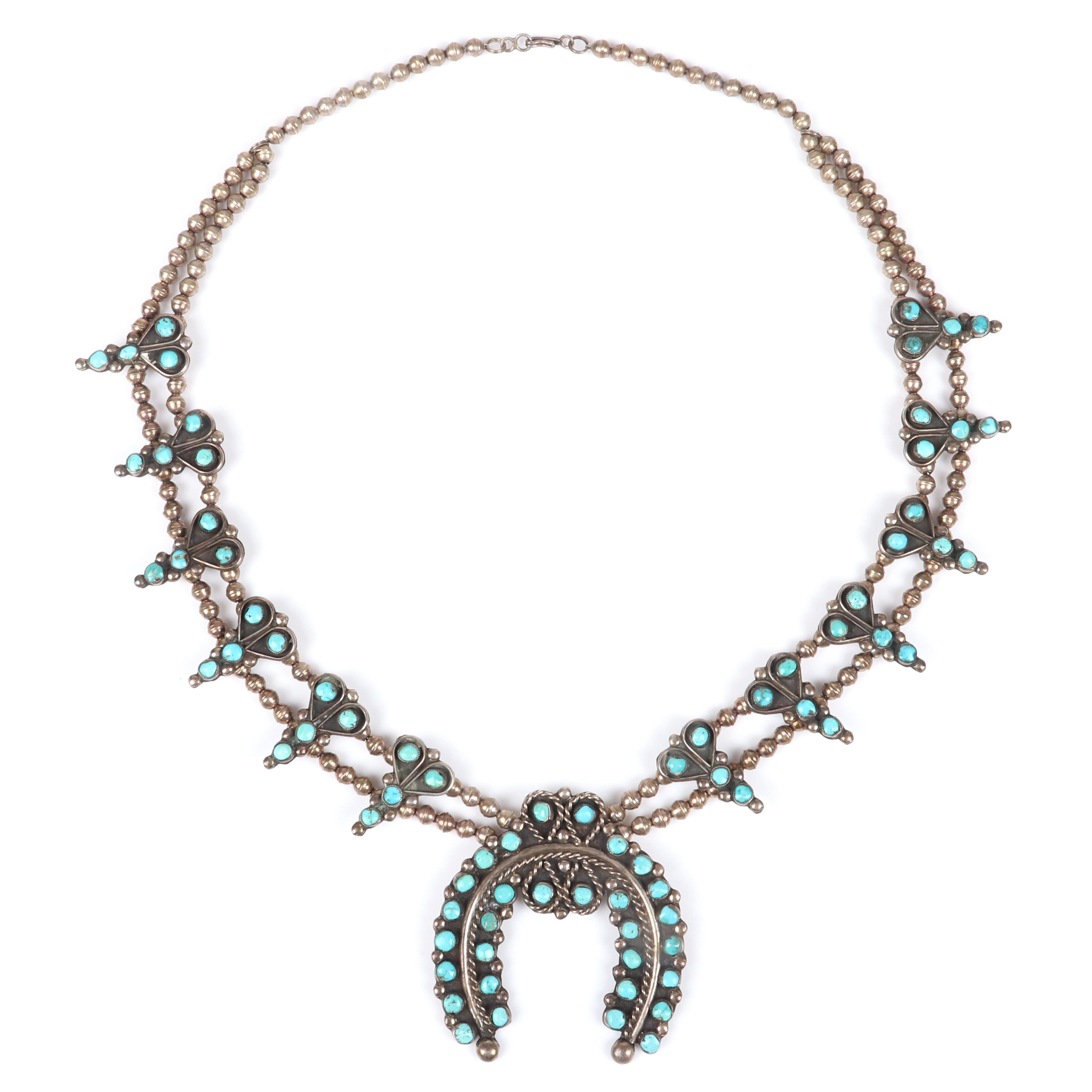 Leonard Weebothee (1923-1992) Zuni Native American Indian Old Pawn turquoise and sterling silver squash blossom necklace with 78 turquoise cabochons & 2 rows of handmade silver beads and large naja withe rope detail. 27""