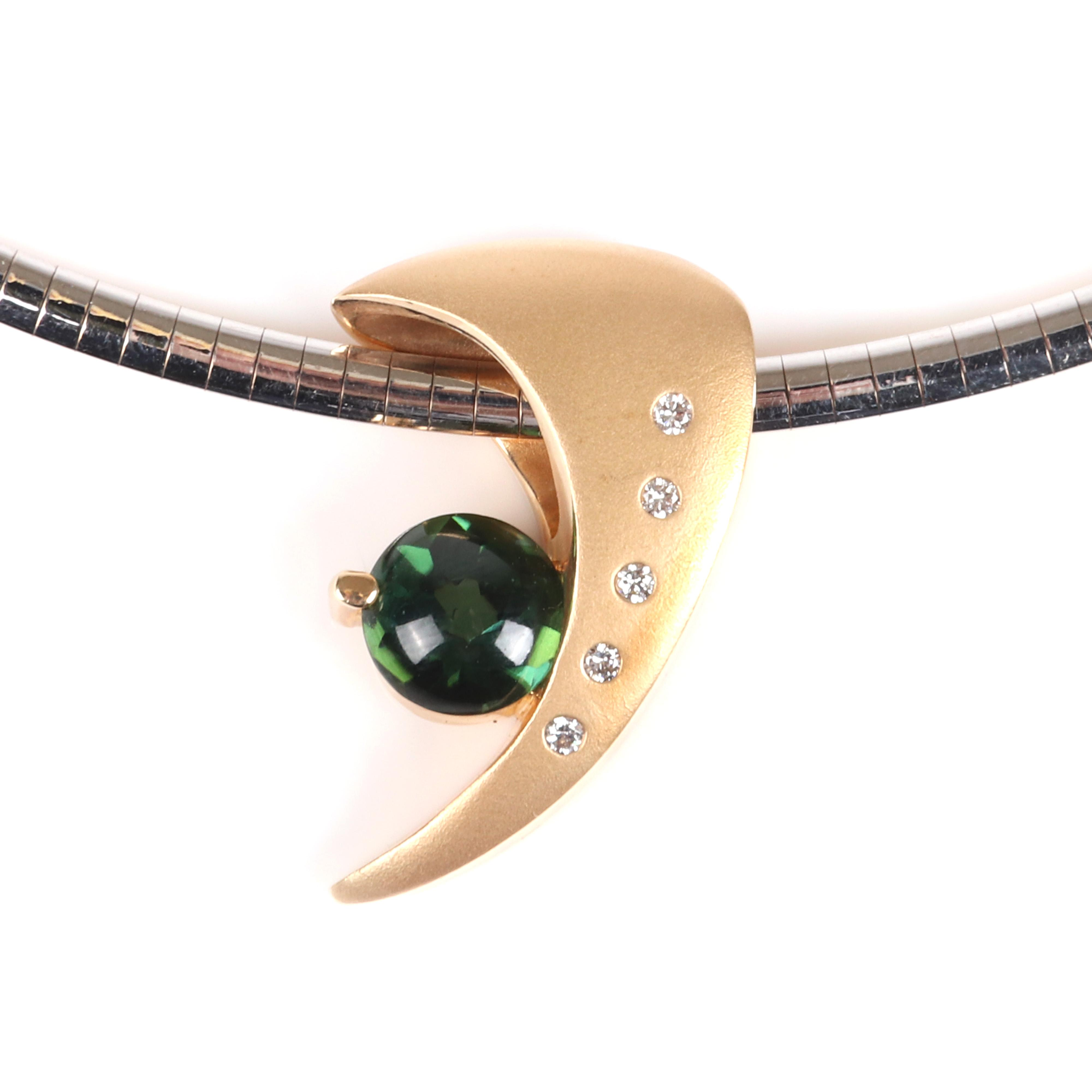 """Designer 14K yellow gold diamond and green tourmaline modernist boomerang pendant with matte and polished finish, signed, on white/yellow gold reversible omega 3mm collar necklace with yellow gold clasp. 16""""L, 1 1/4""""H x"""