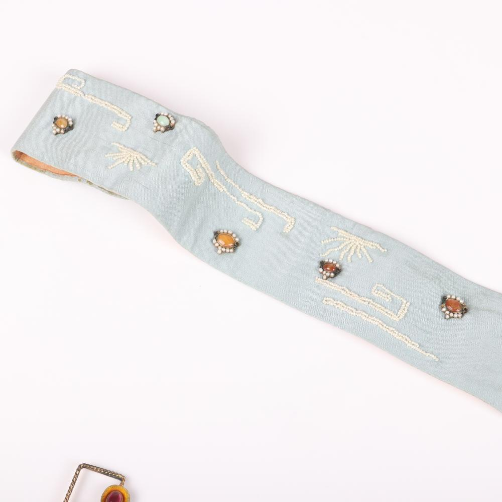 """Percossi Papi for Jane Fonda blue satin and leather belt and with gold gilt decorative jeweled garland design set with jade, aquamarine, cultured pearl, tourmaline, banded agate and semi-stones. 34""""L, 5 1/2""""drop (belt),"""