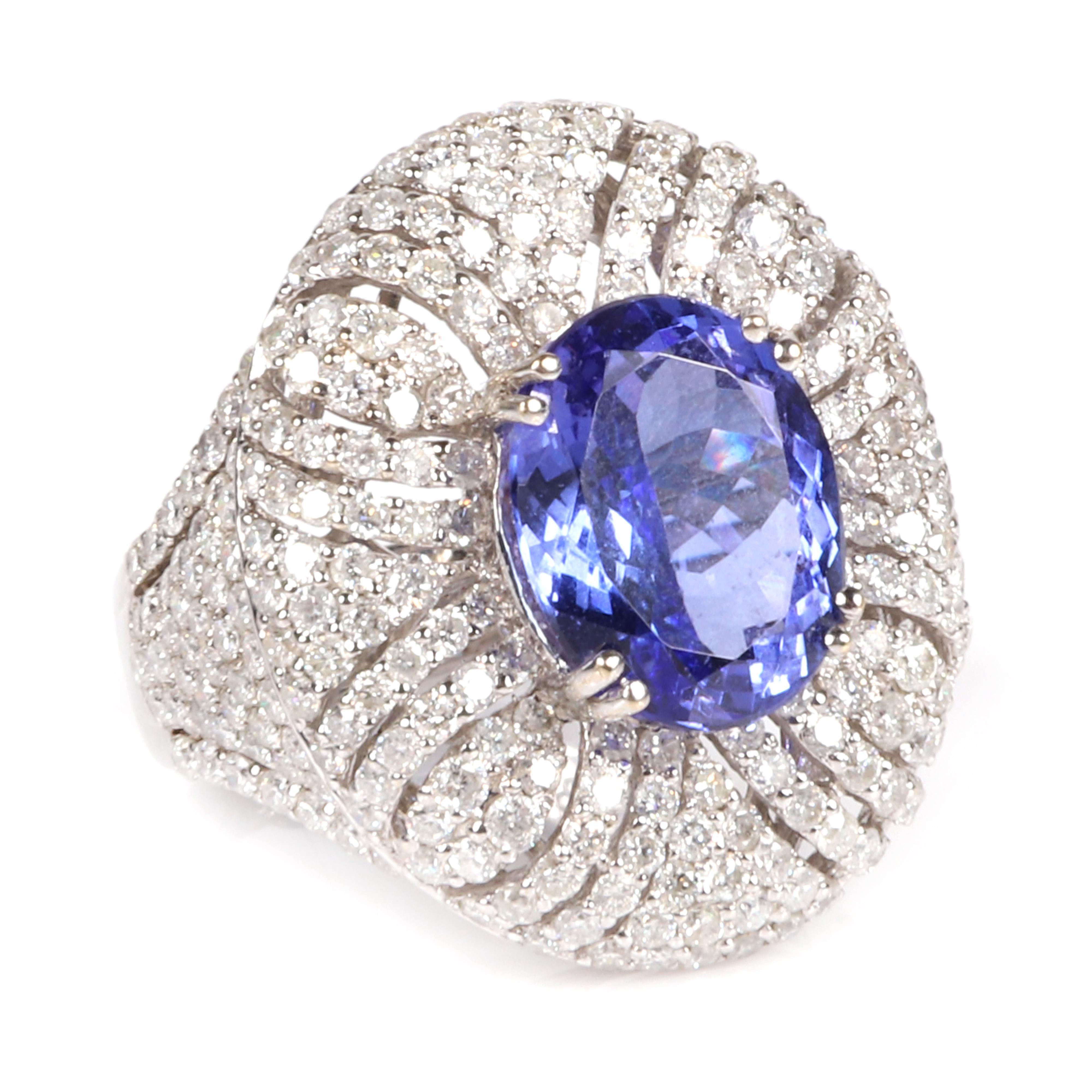 Ladies 18K stamped white gold Tanzanite and diamond ring featuring: Ring size 6 1/2