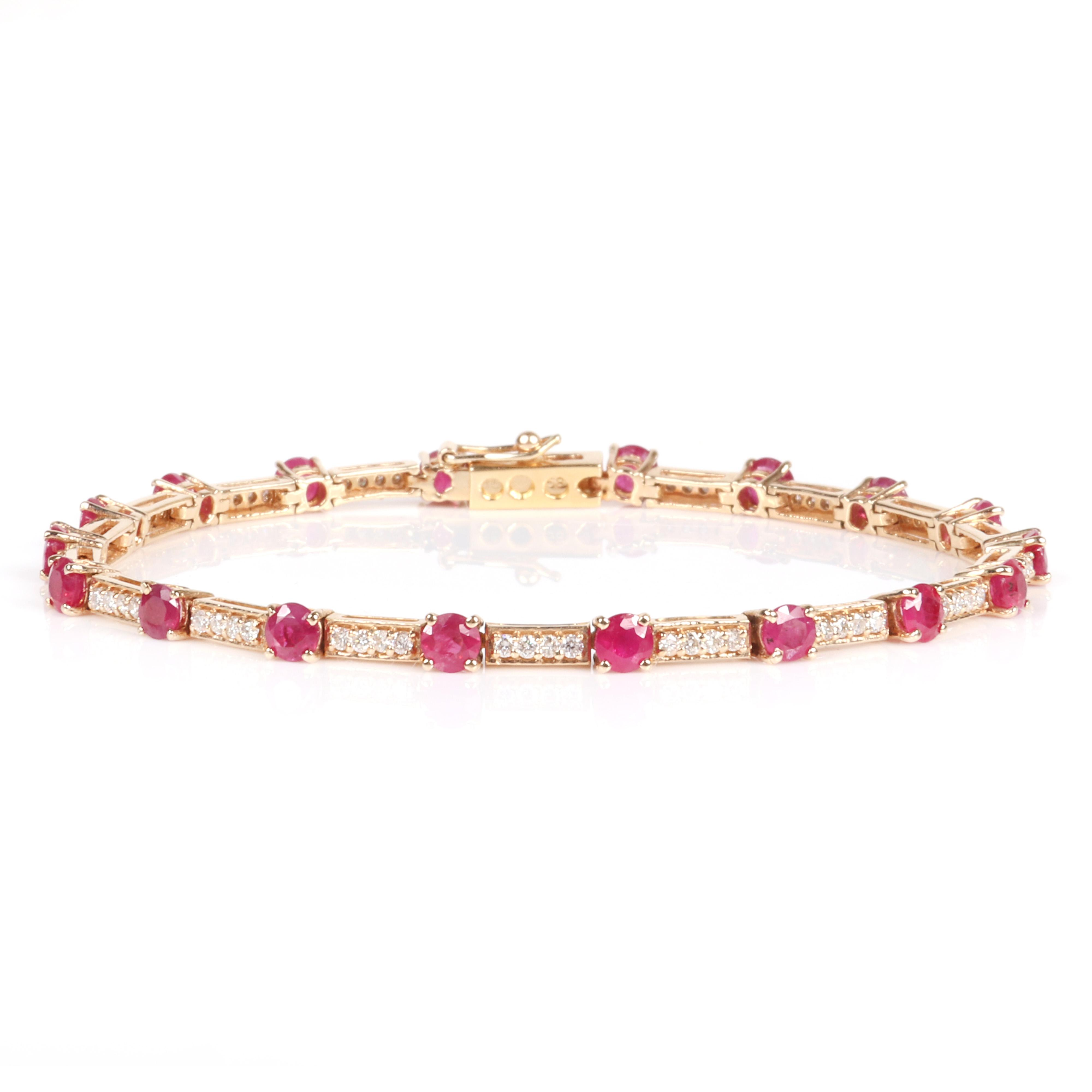 """Lady's 14K Natural Corundum Ruby and Diamond Line Bracelet with yellow gold mounting 8"""" Long. 7.80 dwt."""