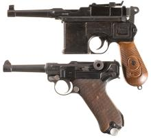 One Luger Pistol and an Inert Broomhandle Copy
