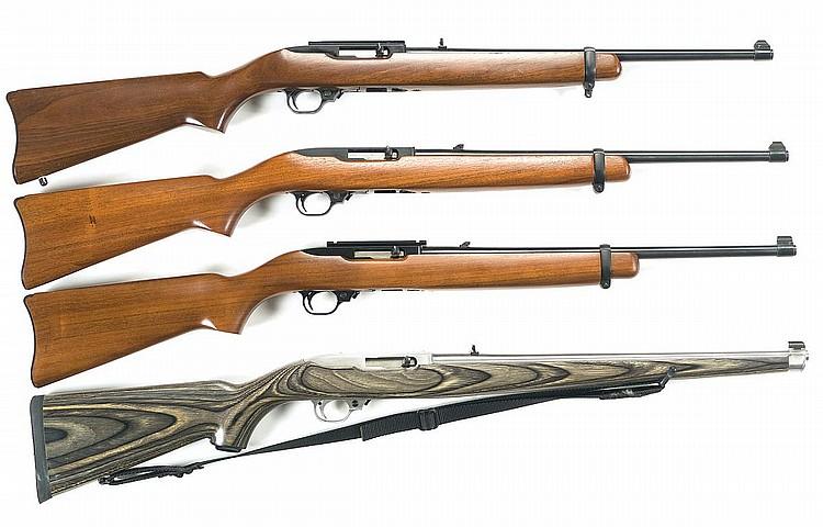 Four Ruger Model 10/22 Carbines -A) Ruger Model 10/22 Standard Semi-Automatic CarbineB) Ruger Model 10/22 Standard Semi-Automatic CarbineC) Ruger Model 10/22 Standard Semi-Automatic CarbineD) Stainless Ruger Model 10/22 Laminated Stock International