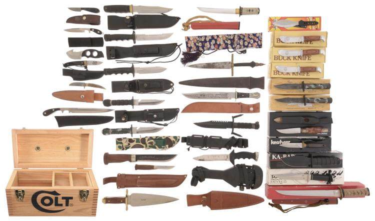 Group of Thirty Knives with Assorted Sheaths and Boxes and Colt Ammunition Crate