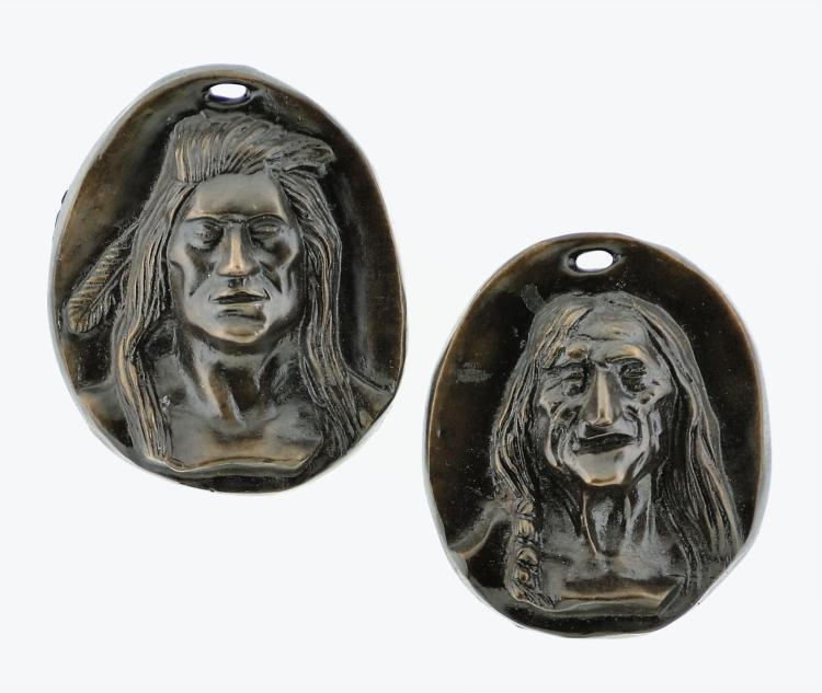 Pair of Charles Marion Russell Indian Head Bronze Plaques
