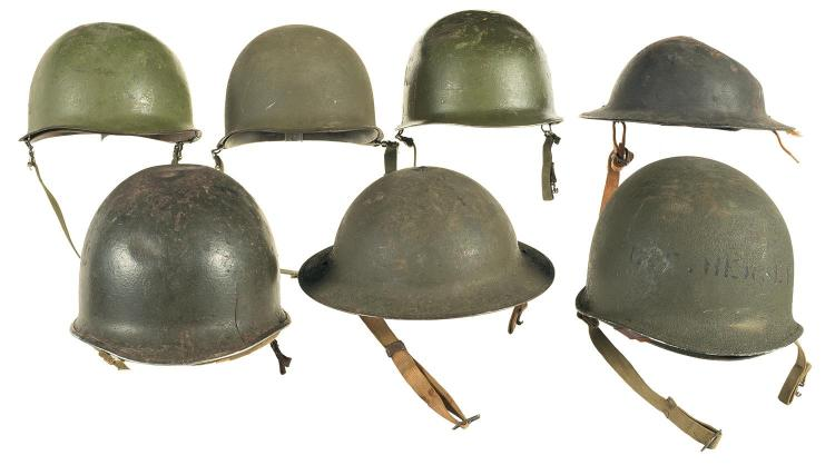 Seven American Military Helmets, Including Two Fixed Bale M1 Helmets