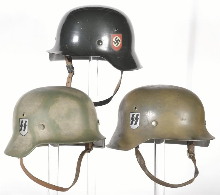 Three German Military Helmets with Nazi Markings