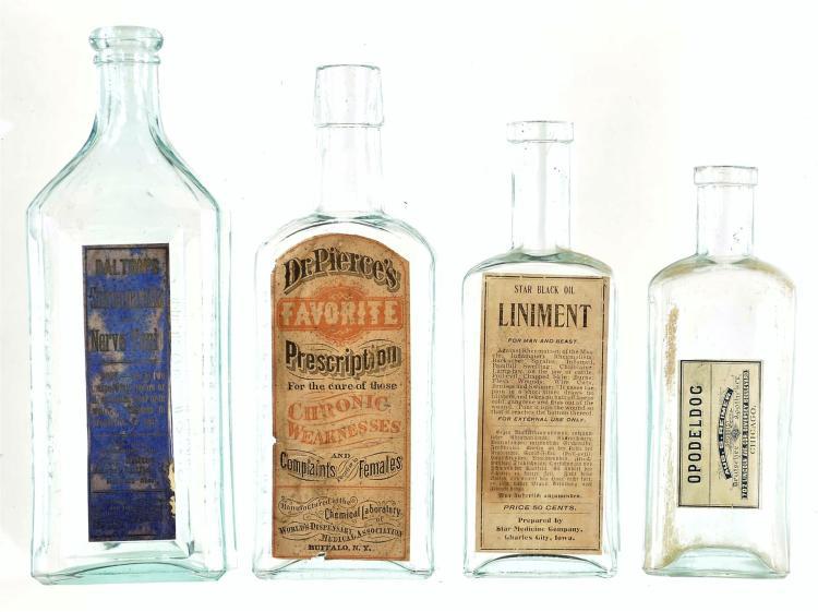 Four Glass Medicine Bottles