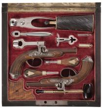 Exceptional Matching Pair of Cased Relief Engraved Pistols