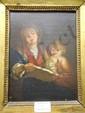 école FRANçAISE du XVIIIe siècle Femme et enfant lisant à la lumière de la bougie Huile sur toile. (rentoilage). Annoté au revers sur la traverse du chassis : SCHALKEN, peintre hollandais du XVIIIe siècle. Haut. : 25 - Larg. : 19 cm.