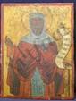 Saint MOINE Il bénit et déroule un phylactère. Grèce XIXe siècle Tempera sur bois. (repeints, fentes et petits manques). Haut. : 40,3 - Larg. : 30,5 cm.