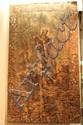 Toile peinte à la façon des tapisseries de lice représentant un Saint arrêtant les loups sur un fond de paysage.