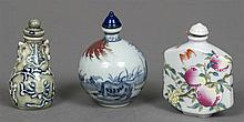 A Chinese porcelain snuff bottle Of squat ovoid form, decorated in the round with a farmer and an oxen, the underside with four character blue painted mark; together with two further Chinese porcelain snuff bottles.  The former 8 cm high.  (3)
