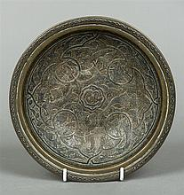 An 18th/19th century Cairo ware dish The interior with scrolling white metal onlays, the underside with inscribed date mark.  20.5 cm diameter.