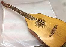 A German lute guitar Of typical construction.  102 cm long.