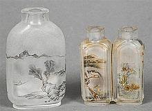 A Chinese inside painted glass twin snuff bottle, together with another larger Both decorated with mountainous landscapes and calligraphic script.  The former 5 cm high. (2)