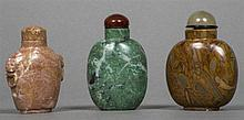 Three Chinese carved hardstone snuff bottles and stoppers Of typical form.  The larger 7.5 cm high.  (3)