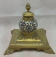 A Victorian brass mounted pottery inkwell The spherical body worked with floral strapwork.  14 cm high.