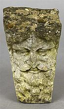 An antique stone carving Modelled as a Bacchic mask.  37.5 cm high.