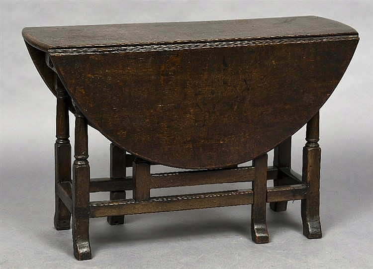 An 18th century oak gateleg table the twin flap oval top abo - Gateleg table with drawers ...