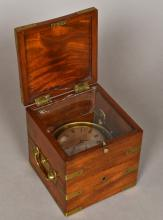 A 19th century marine chronometer The silvered dial with Roman numerals and