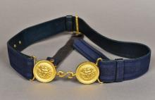 A French military belt Centred with a twin mask roundel ormolu buckle.  The