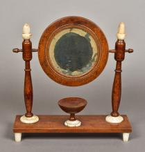 A 19th century Continental shaving mirror The circular mirror plate support