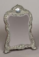 An Edwardian silver dressing table mirror, hallmarked Birmingham 1903, make