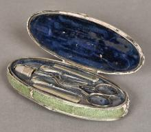 A George III white metal mounted shagreen covered etui Of oval form, the hi