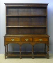 An 18th century oak dresser The moulded rectangular cornice above two shelv