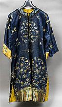 A 19th century or earlier Chinese embroidered silk jacket Worked with flora