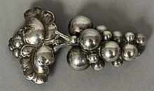 A Georg Jensen silver pendant brooch Modelled as a bunch of grapes, stamp m